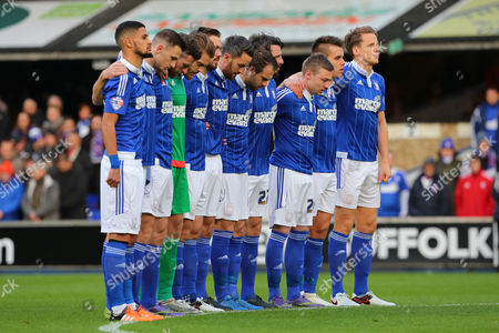 Stock Photo of Ipswich Town players line up during the minutes silence held in respect for the terror attacks in Paris and in remembrance of former goalkeeper, Marton Fulop - Ipswich Town v Wolverhampton Wanderers, Sky Bet Championship, Portman Road, Ipswich. 21.11.15. Picture by Richard Calver