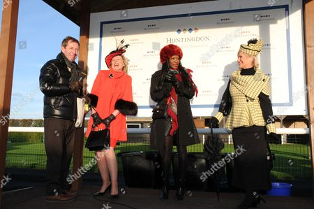 Winter Ladies Day finalists at Huntingdon enjoy a joke with Derek Thompson.