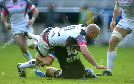 Stock Picture of Brendon Leonard of Ospreys is tackled by Camille Lopez of Clermont Auvergne.