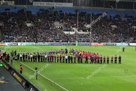 Stock Photo of Both teams line up for a minutes silence to honour the victims of the Paris bombings and Jonah Lomu during the European Rugby Champions Cup match between Wasps and Toulon played at The Ricoh Arena, Coventry, on November 22nd 2015