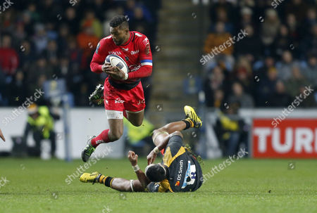 Delon Armitage of Toulon hurdles the tackle of Nathan Hughes of Wasps during the European Rugby Champions Cup match between Wasps and Toulon played at The Ricoh Arena, Coventry, on November 22nd 2015