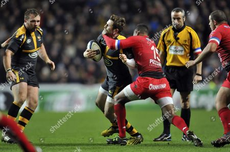 Stock Picture of Elliot Daly of Wasps is tackled high by Delon Armitage of Toulon