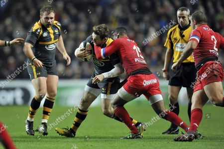 Elliot Daly of Wasps is tackled high by Delon Armitage of Toulon