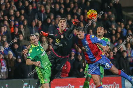 Sunderland goalkeeper Costel Pantilimon fists the ball off Crystal Palace forward Marouane Chamakh head during the Barclays Premier League match between Crystal Palace and Sunderland at Selhurst Park, London