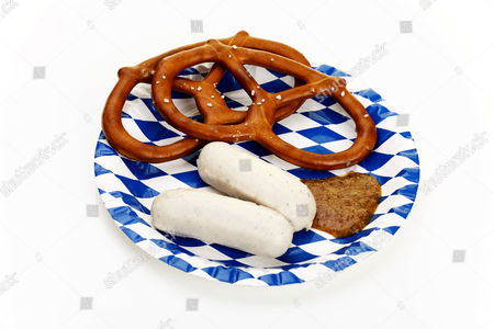 Veal sausages, salted pretzels and sweet mustard on a Bavarian plate
