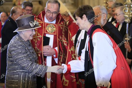 Queen Elizabeth II meets the Bishop of Stockport, the Right Reverend Libby Lane and the The Very Reverend John Hall, Reverend The Very Reverend John Hall (centre) as she arrives at Westminister Abbey