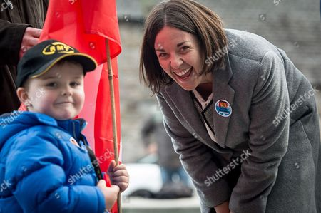 Scottish Labour leader, Kezia Dugdale meets four year old Jack MacDonald, from Inchinnan, who accompanied his father, John, a ferry worker to the protest