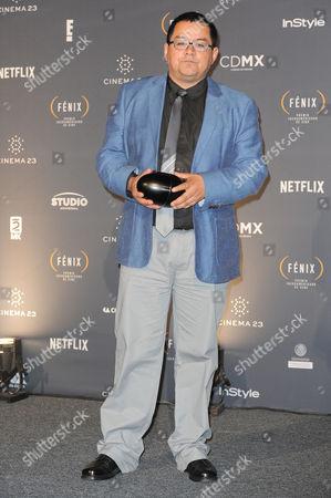 Stock Image of Daniel Villalobos received award for the best script at Fenix Iberoamerican Film Awards Photocall at Teatro de la Ciudad