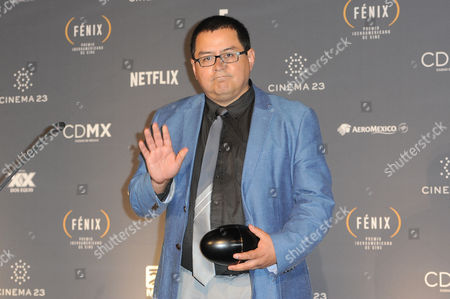 Stock Picture of Daniel Villalobos received award for the best script at Fenix Iberoamerican Film Awards Photocall at Teatro de la Ciudad