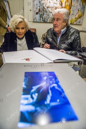 Honor Blackman signs copies of the book