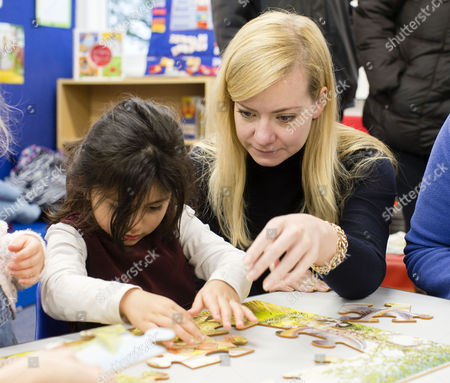 Oxford West and Abingdon MP Nicola Blackwood helps a child with a jigsaw visits the new Cumnor Pre School Nursery