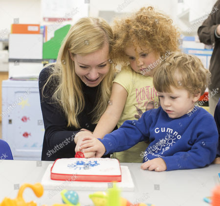 Oxford West and Abingdon MP Nicola Blackwood cuts a cake helped by children at the school visits the new Cumnor Pre School Nursery.