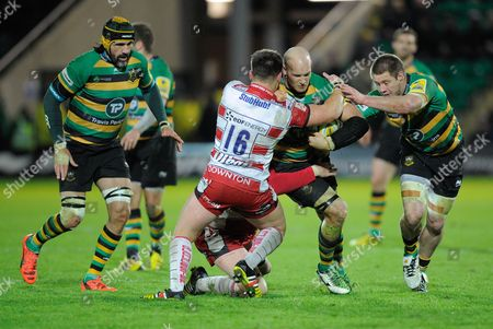 Victor Matfield looks on as Sam Dickinson of Northampton Saints is tackled by Darren Dawidiuk of Gloucester during the Aviva Premiership match between Northampton Saints and Gloucester played at Franklin's Gardens, Northampton on the 27th of November, 2015