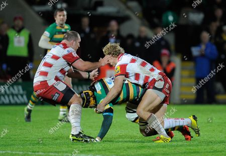 Victor Matfield of Northampton Saints is tackled by Billy Twelvetrees of Gloucester during the Aviva Premiership match between Northampton Saints and Gloucester played at Franklin's Gardens, Northampton on the 27th of November, 2015