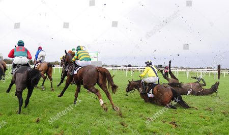 FAIRYHOUSE. Jockeys ADRAIN HESKIN (Sammy Black,yellow) and GER FOX (Strongpoint,right) hit the deck at the 1st fence and thankfully all were ok afterwards.