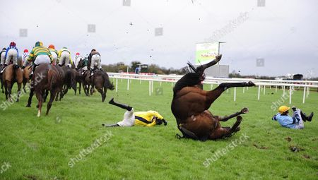 FAIRYHOUSE. Jockeys ADRAIN HESKIN (Sammy Black,yellow) and GER FOX (Strongpoint) hit the deck at the 1st fence and thankfully all were ok afterwards.