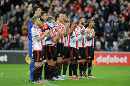 Stock Picture of Sunderland players observe a minute's applause for former player Marton Fulop who passed away from cancer during the Barclays Premier League match between Sunderland and Stoke City played at Stadium of Light, Sunderland, on the 28th November 2015