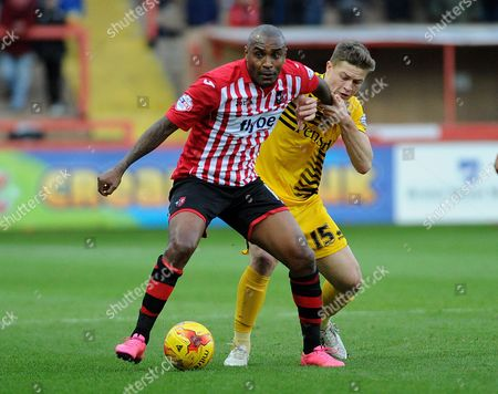 Clinton Morrison of Exeter City holds off James Clarke of Bristol Rovers