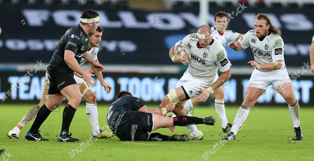 Lou Reed of Cardiff Blues is tackled by Sam Parry of Ospreys.