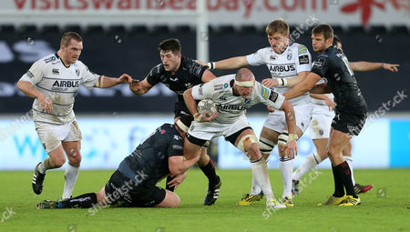 Lou Reed of Cardiff Blues is tackled by Ryan Bevington of Ospreys.