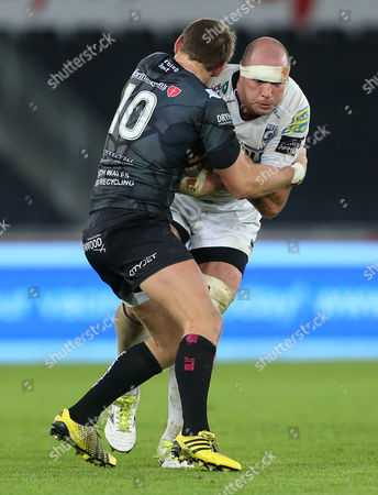 Lou Reed of Cardiff Blues is tackled by Dan Biggar of Ospreys.