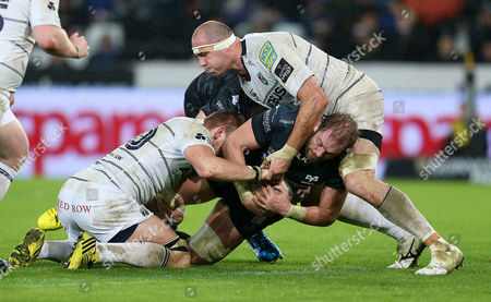 Alun Wyn Jones of Ospreys progress towards the try line is halted by Ethan Lewis and Lou Reed of Cardiff Blues.