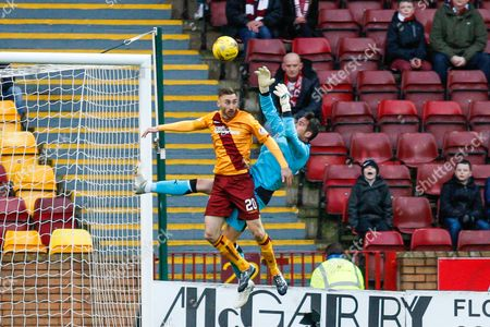 Motherwell FC Forward Louis Moult challenges Hearts FC Goalkeeper Neil Alexander for the cross during the Ladbrokes Scottish Premiership match between Motherwell and Heart of Midlothian at Fir Park, Motherwell