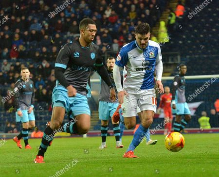 Sheffield Wednesday Defender, Liam Palmer and Blackburn Rovers Midfielder, Craig Conway chase for a loose ball during the Sky Bet Championship match between Blackburn Rovers and Sheffield Wednesday at Ewood Park, Blackburn