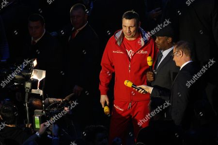 Stock Picture of Wladimir Klitschko (l) is interviewed by RTL's Florian Koenig (r) and Lennox Lewis (c). UK SALES ONLY