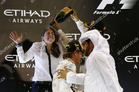Stock Image of Kimberly Stevens (Mercedes AMG Petronas Formula One Team), Lewis Hamilton (GBR, Mercedes AMG Petronas Formula One Team), Nico Rosberg (GER, Mercedes AMG Petronas Formula One Team)