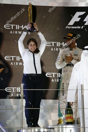 Stock Photo of Kimberly Stevens (Mercedes AMG Petronas Formula One Team), Lewis Hamilton (GBR, Mercedes AMG Petronas Formula One Team)