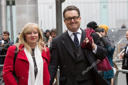 Andrew Fitch-Holland leaving Southwark Crown Court with his fiancee Ruth