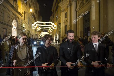 Luca Calvani (R), Tiziana Cuscuna (C) and Nathalie Rapti Gomez (L) cut a ribbon