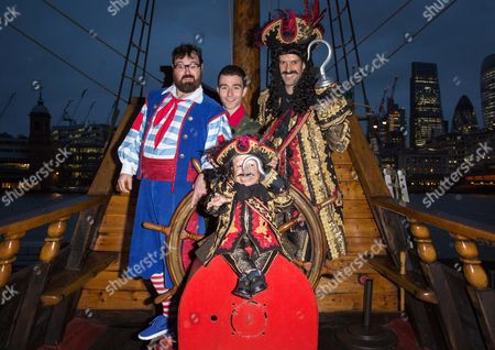 Stock Picture of Jarred Christmas as Smee, George Ure as Peter Pan, Marcus Brigstocke as Captain Hook and Verne Troyer as Lofty the Pirate