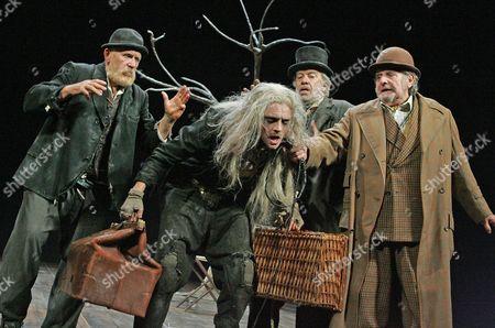 Stock Photo of 'Waiting for Godot' - Alan Opie (Estragon), Richard Dormer (Lucky), James Laurenson (Vladimir) and Terence Rigby (Pozzo)