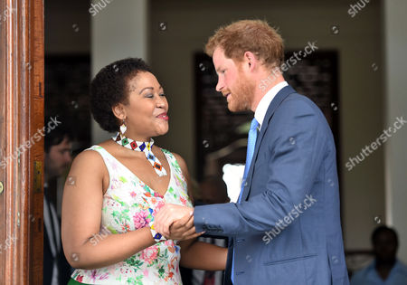 Stock Picture of Thobeka Mabhija welcomes Prince Harry at her home in Pretoria