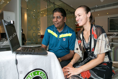 Stock Picture of Vijay Amritraj and Martina Hingis during an internet fan chat