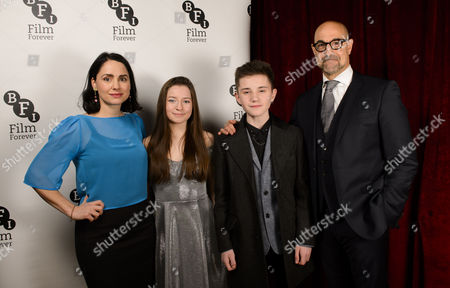 Stock Picture of Stanley Tucci (Hook) and Laura Fraser (Mrs Darling) with Hazel Doupe (Wendy) and Zak Sutcliffe (Peter)