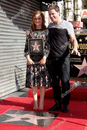 Amy Poehler and Greg Poehler