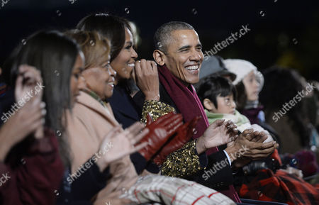 United States President Barack Obama and daughters Malia and Sasha, mother-in-law Marian Robinson and first lady Michelle Obama
