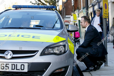 Stock Picture of Labour MP Neil Coyle talking to police officers stationed outside his office