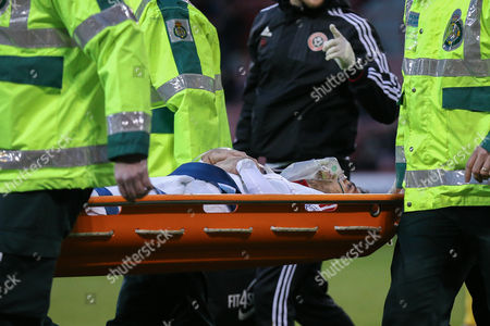Sheffield United defender Robert Harris stretchered off  during the The FA Cup match between Sheffield Utd and Oldham Athletic at Bramall Lane, Sheffield