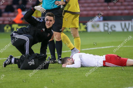 Sheffield United defender Robert Harris  lies injured  during the The FA Cup match between Sheffield Utd and Oldham Athletic at Bramall Lane, Sheffield