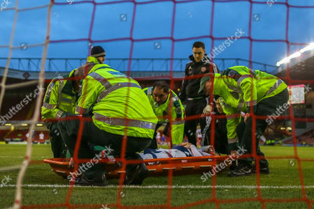 Sheffield United defender Robert Harris  lies injured on the ground and has to be stretchered off during the The FA Cup match between Sheffield Utd and Oldham Athletic at Bramall Lane, Sheffield