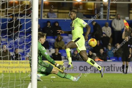 Huddersfield Town striker Ishmael Miller shot is saved by Birmingham City goalkeeper Tomasz Kuszczak during the Sky Bet Championship match between Birmingham City and Huddersfield Town at St Andrews, Birmingham