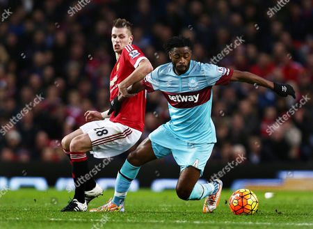 Alexandre Song of West Ham United and Morgan Schneiderlin of Manchester United during the Barclays Premier League match between Manchester United and West Ham United played at Old Trafford, Manchester on December 5th 2015
