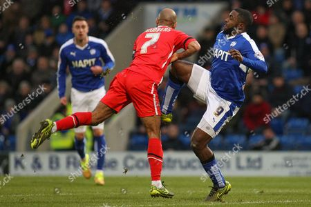 A high-leg from Chesterfield FC forward Sylvan Ebanks-Blake on Walsall FC midfielder Adam Chambers during the The FA Cup match between Chesterfield and Walsall at the Proact stadium, Chesterfield