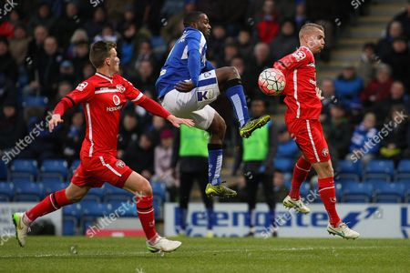 Chesterfield FC forward Sylvan Ebanks-Blake challenges for the ball in the air during the The FA Cup match between Chesterfield and Walsall at the Proact stadium, Chesterfield