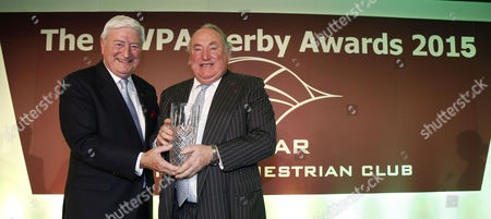 Laurie Brennan (left) presents Anthony Oppenheimer with Owner of the Year at The HWPA Derby Awards The Derby Awards