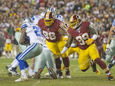 Washington Redskins defensive tackle Terrance Knighton (98) and defensive tackle Ricky Jean Francois (99) pursue Dallas Cowboys running back Darren McFadden (20) in early first quarter action at FedEx Field in Landover, Maryland. The Cowboys won the game 19-16.